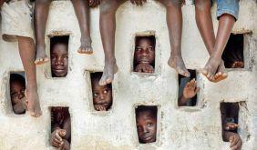 Children watch an Oxfam team at work, by Timothy Allen